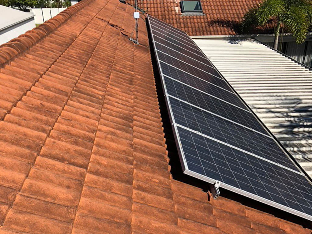 Dirty roofing and solar panel demands solar panel cleaning and roof cleaning service